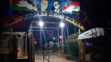 The Assads' pictures at the entrance to a children's playground  in Douma
